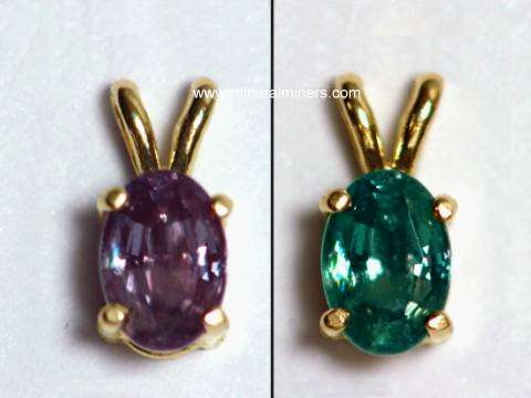 link to page displaying handcrafted jewelry of <em>ALL</em> Minerals (image is of a natural alexandrite pendant in 14k gold showing its color-change)
