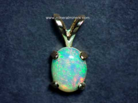 Opal jewelry ethiopian opal jewelry ethiopian opal pendant in 14k gold item mozeypictures Choice Image